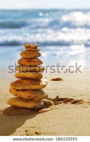 Stone pyramid on the beach - stock photo