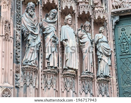 Stone sculptures on the exterior of the Cathedral in Strasbourg, the capital of the Alsace northeastern region in France  - stock photo