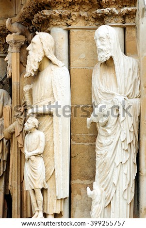 Stone sculptures on the facade of the cathedral Notre-Dame de Reims, France - stock photo
