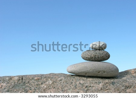 Stone stack against the clear sky - stock photo
