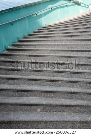 Stone staircase with iron railing. - stock photo