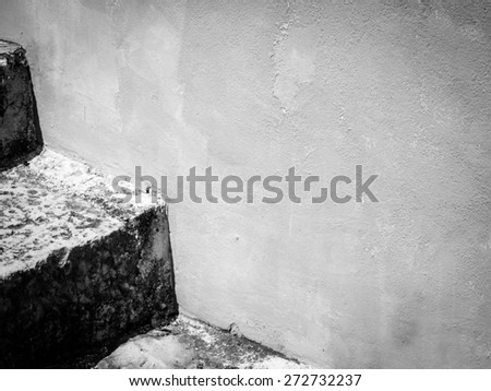stone stairs and wonderful colored house wall - stock photo