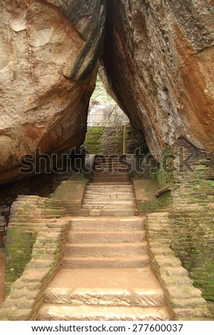Stone stairs between two big rocks - stock photo