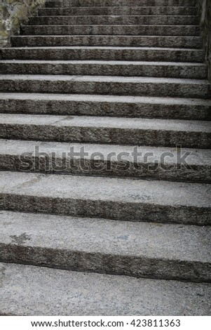 Stone stairs in the old part of a European village. - stock photo