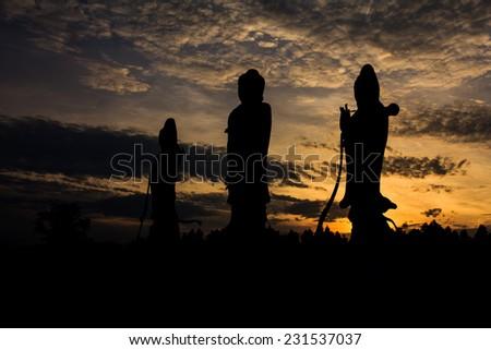 Stone statue of a Buddha at Sa Kaeo Thailand. - stock photo
