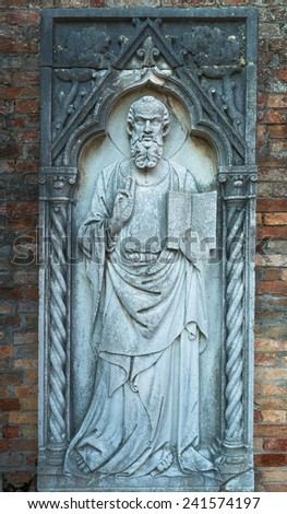 Stone statue of a saint in the ruins on the island of Torcello, in Venice, Italy - stock photo