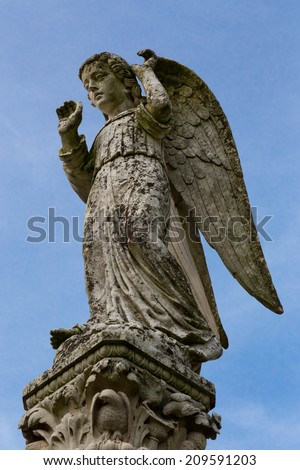 Stone statue of an angel in the French countryside. - stock photo