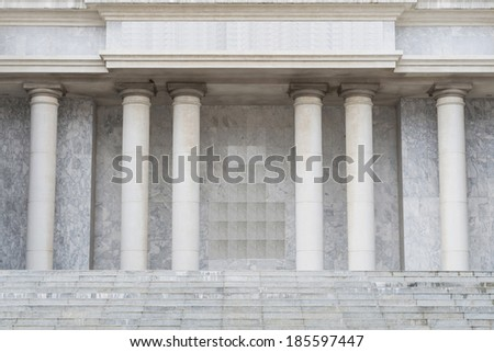 Stone steps and entry way with columns - stock photo