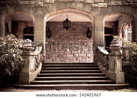 Stone steps and entryway to portico with vintage toning - stock photo