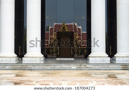 Stone steps and entryway with pole - stock photo
