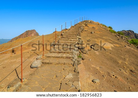 Stone steps on trekking trail to Pico Ruivo, highest peak on Madeira island, Portugal  - stock photo
