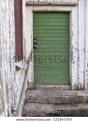 Stone steps to the door of an old abandoned house - stock photo