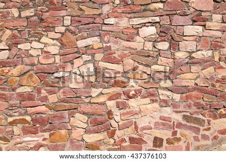 Stone texture on the walls of Fateh Pur Sikiri - stock photo