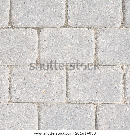Stone tile floor paving fragment as an abstract background composition - stock photo
