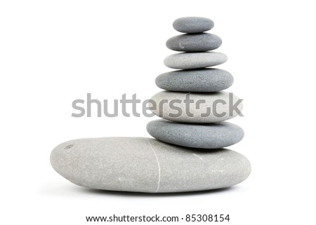 Stone tower isolated on white - stock photo