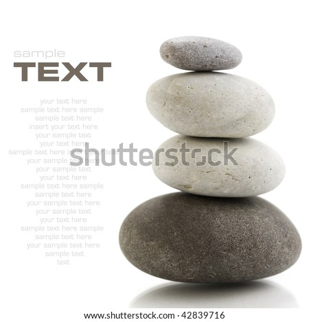 Stone tower with reflection on white background. With sample text - stock photo