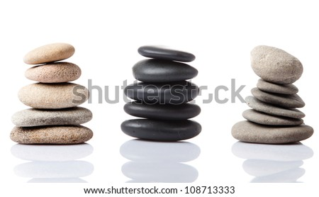 stone towers. Balanced Zen stones on white background - stock photo