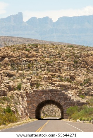 stone tunnel and Sierra Del Carmen mountains - stock photo