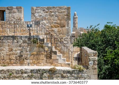stone wall around the Old City of Jerusalem - stock photo