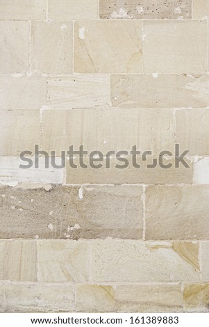 Stone wall background, detail of a wall decorated with stone textured background - stock photo