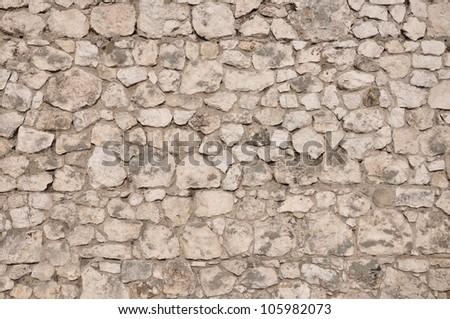 Stone wall background, old limestone - stock photo