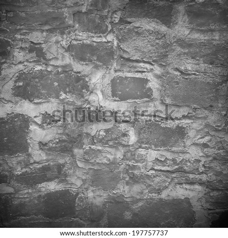 stone wall background texture and dark vignette - stock photo