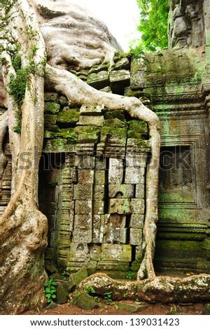 Stone Wall of Temple in Angkor Thom, Cambodia - stock photo