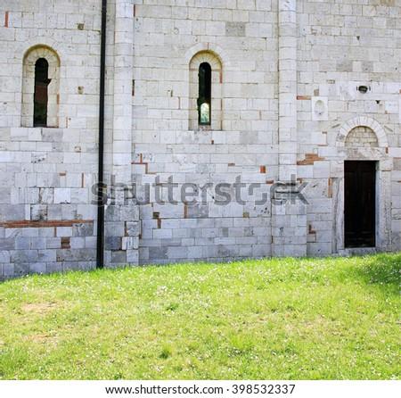 Stone wall of the Abbey of Sant'Antimo, near Montalcino, Tuscany, Italy       - stock photo