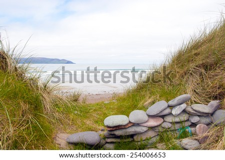 stone wall shelter on a beautiful beach in the maharees county Kerry Ireland - stock photo