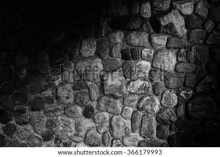 Stone wall texture background closeup with light black and white - stock photo