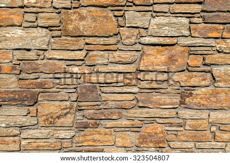 stone wall -  wall rock solid grey background cement frame  pattern block surface closeup wallpaper rough - stock photo