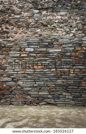 Stone wall with floor - stock photo