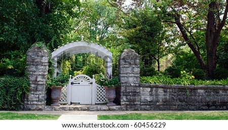 Stone Wall with Garden Gate - stock photo