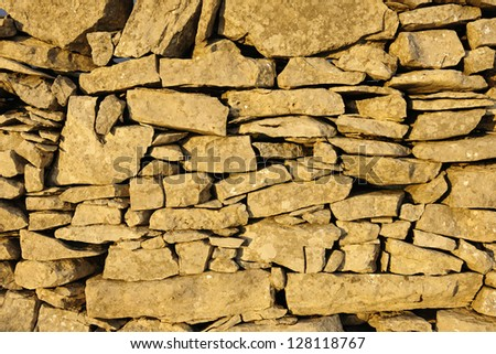 Stone wall with sky - stock photo