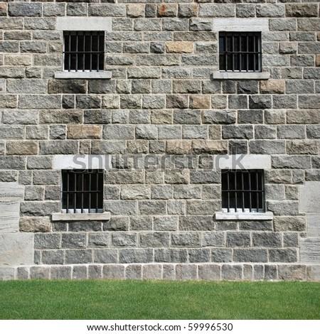 Stone window with metal lattice - stock photo