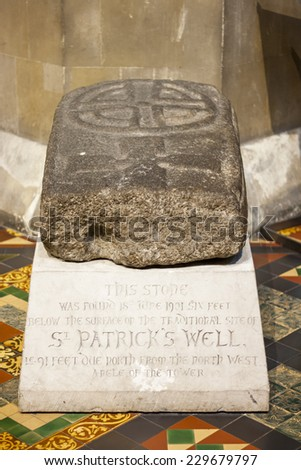 Stone with The Saint Patricks Cross found near to The Saint Patricks Cathedral in Dublin, Ireland - stock photo