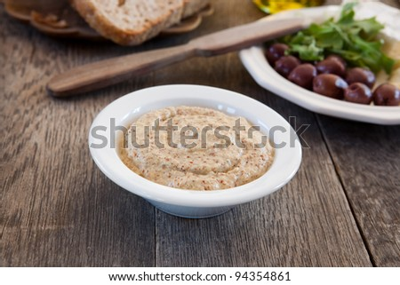 Stoneground mustard sauce in a bowl - stock photo
