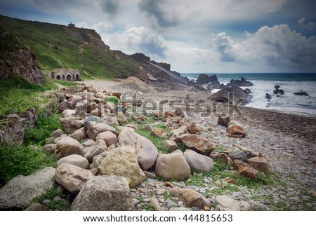 Stones and pebbles on the beach at Bude, Cornwall, England. - stock photo