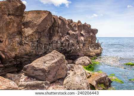 Stones and the nature of the coastline of the Pacific Ocean, Easter Island, Chile - stock photo