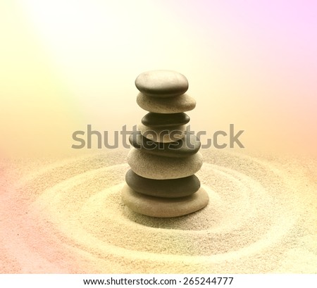 Stones balance and harmony in zen meditation garden relaxation and simplicity for concentration. Sand and stone.  - stock photo