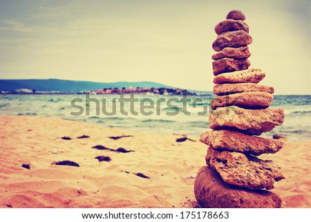 Stones balance over blue sea in vintage colors/ Summer holiday beach background/ Scene Sea Memories - stock photo