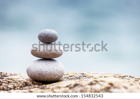 Stones balance, pebbles stack over blue sea. Crimea, Ukraine, Europe. Beauty world. - stock photo