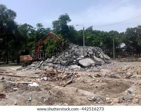 Stones, destroyed buildings, building. Demolition. A pile of stones. Crane - stock photo