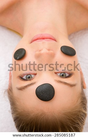 stones face of a woman in spa - stock photo