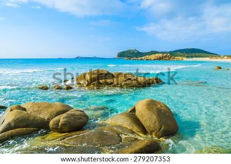 Stones in crystal clear water of Villasimius beach, Sardinia island, Italy - stock photo