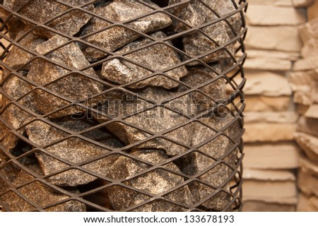 stones in the sauna stove - stock photo