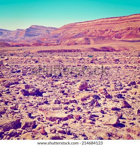 Stones of Grand Crater in Negev Desert, Israel, Instagram Effect - stock photo