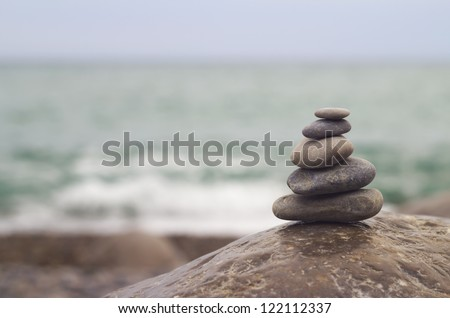 Stones on the beach against the sea - stock photo