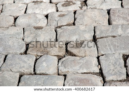 Stones paving the old texture background - stock photo