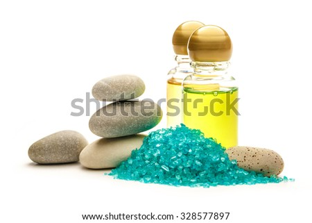 Stones, sea salt and shampoo bottles on white - stock photo